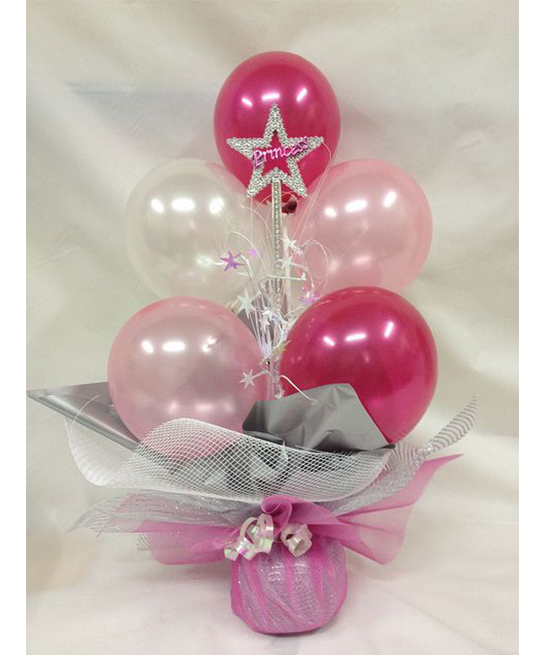 Centro de mesa con globos rosas